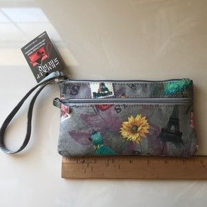 Super cute wristlet with phone charger backup